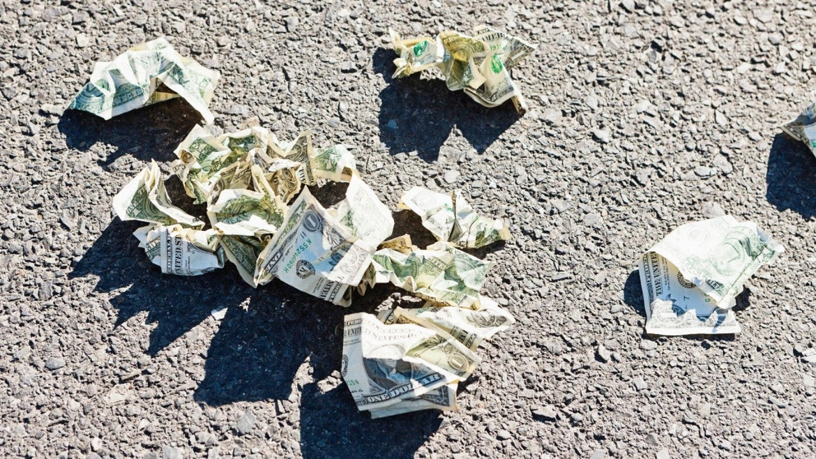 File photo of cash on the street
