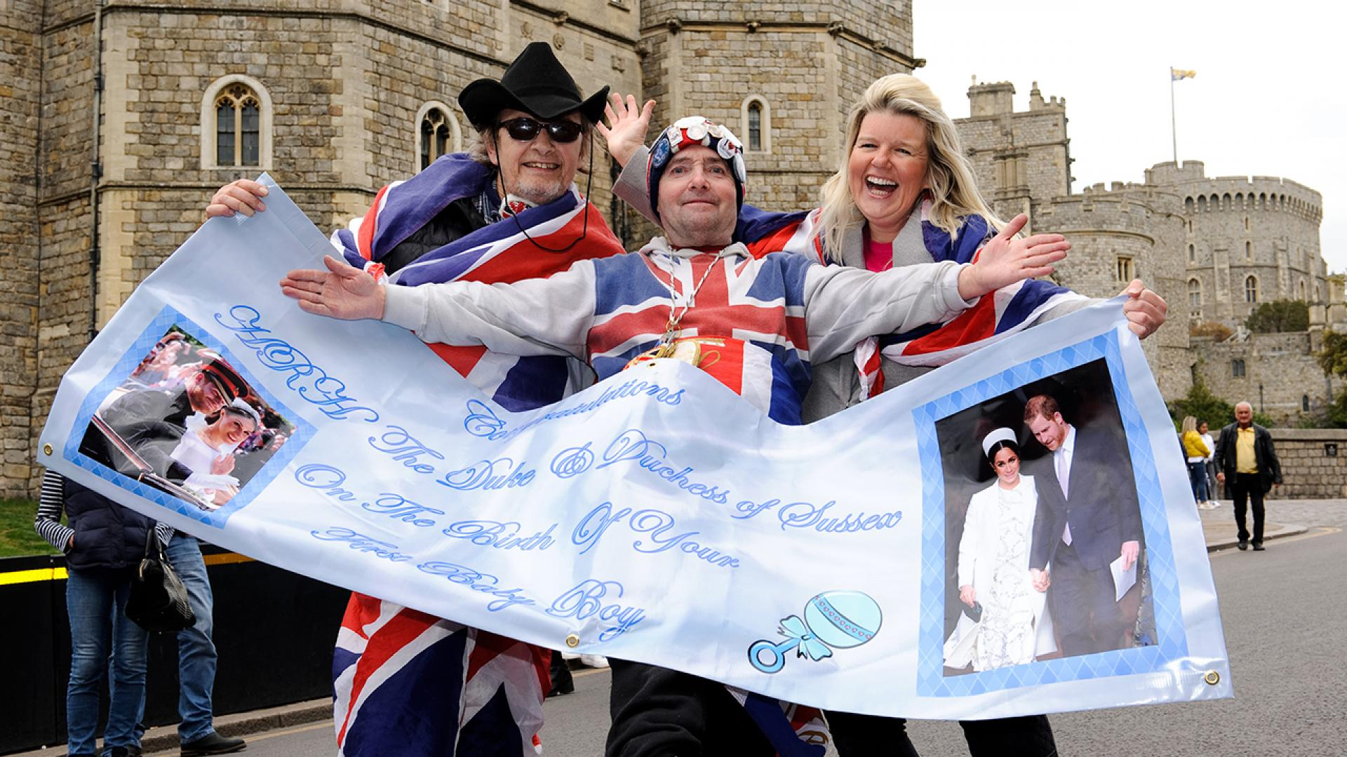 Revelers celebrate outside Windsor Castle after the announcement of the royal baby's birth on May 6, 2019.