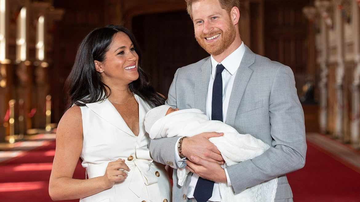 Meghan Markle poses with her son, Archie, and husband, Prince Harry.