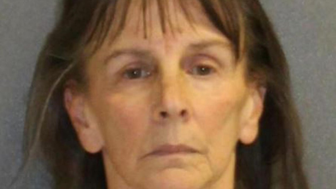Day care worker says she lost her temper and slapped, threw toddlers, police said.