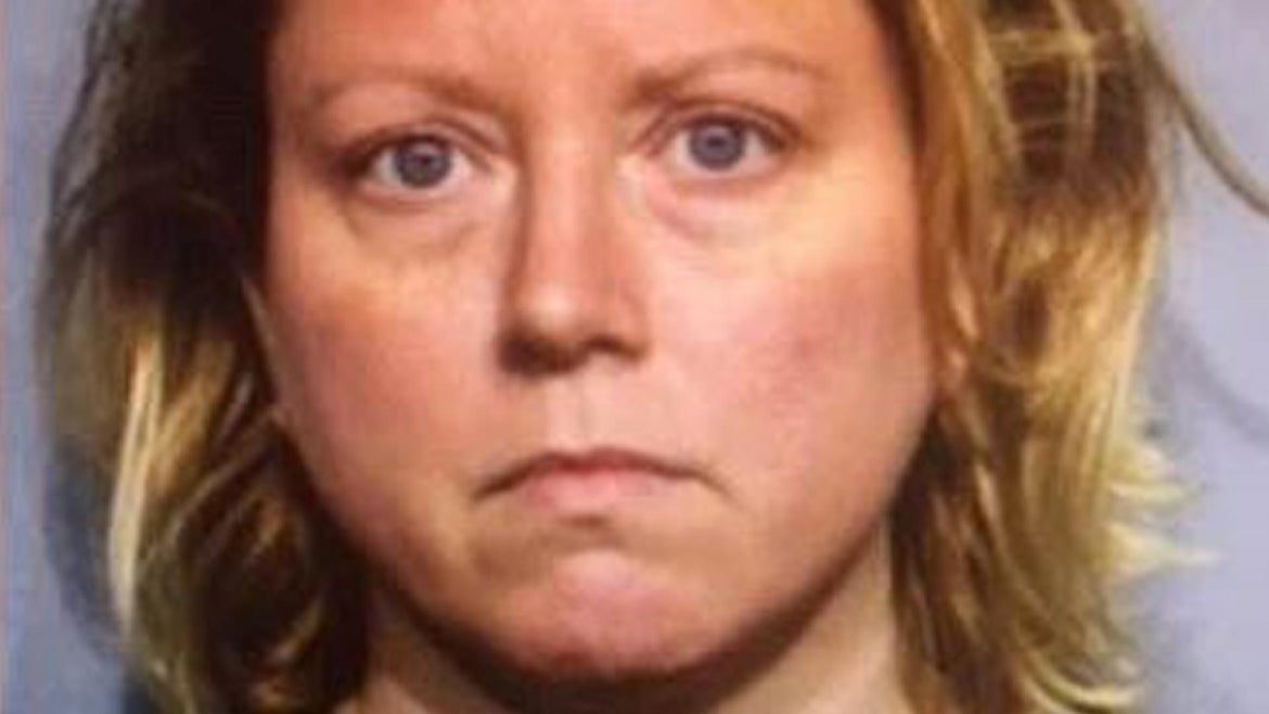 Deborah Jane Martin, 43, was arrested and charged with two counts of first-degree murder Saturday in the killings of her father, 72-year-old David Martin, and her mother, 71-year-old Anne Martin, at the suburban Chicago home they all shared.
