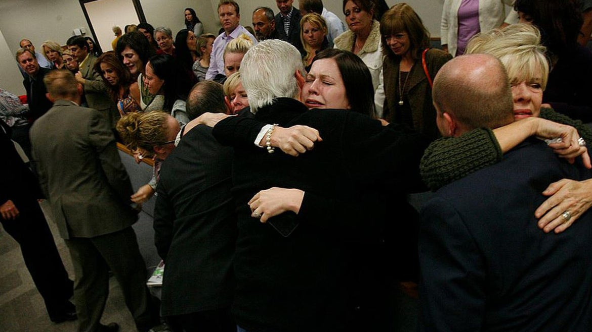 Relatives of Michele MacNeill embrace after her husband is found guilty of murdering her.