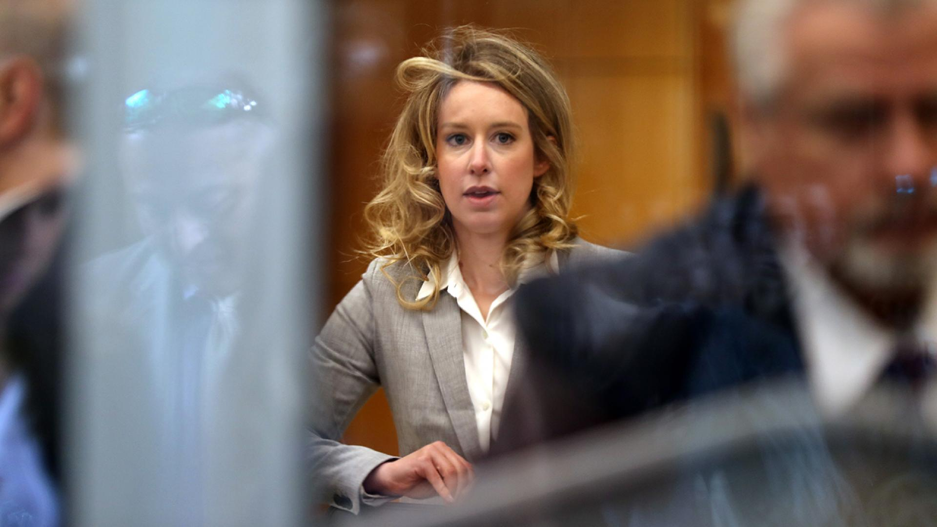 Elizabeth Holmes appears in court with curly hair on June 28, 2019.