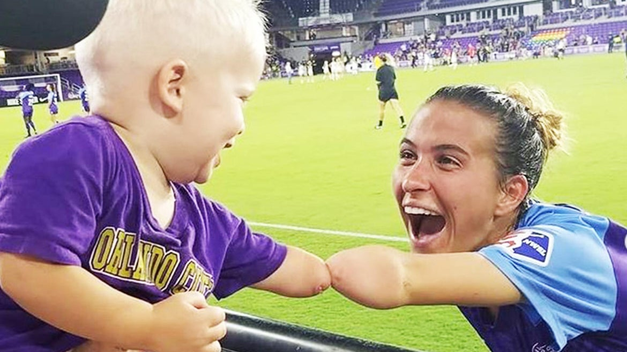 Little Joseph Tidd shared a sweet fist bump with Orlando Pride soccer player Carson Pickett.