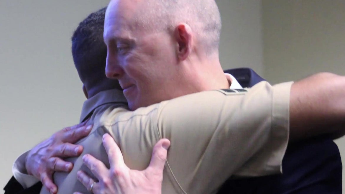 A retiring FBI agent was reunited with the baby he saved 22 years ago.