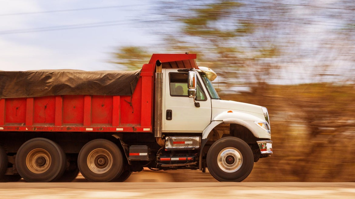A man allegedly evading police capture in a dump truck.