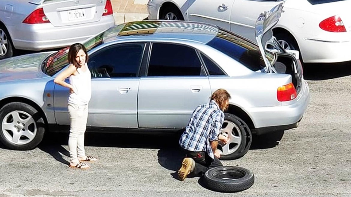 Charles Logan, 56, stopped to help a woman change her tire.