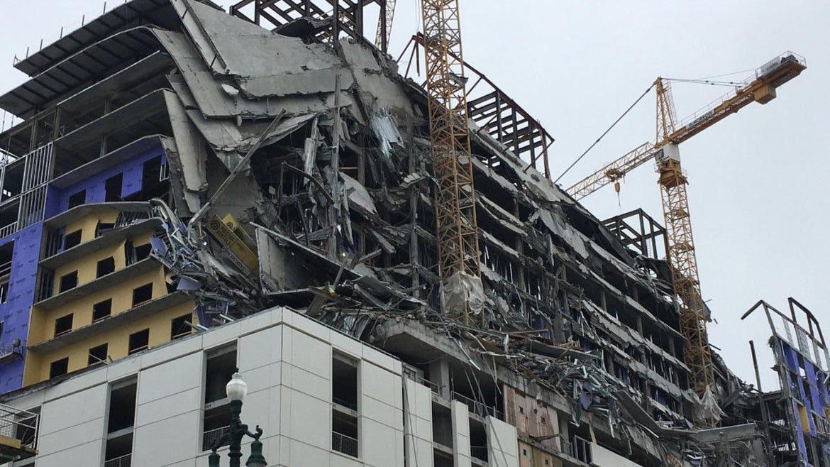 A hotel under construction in New Orleans collapsed on Saturday, leaving one person dead and at least three missing.