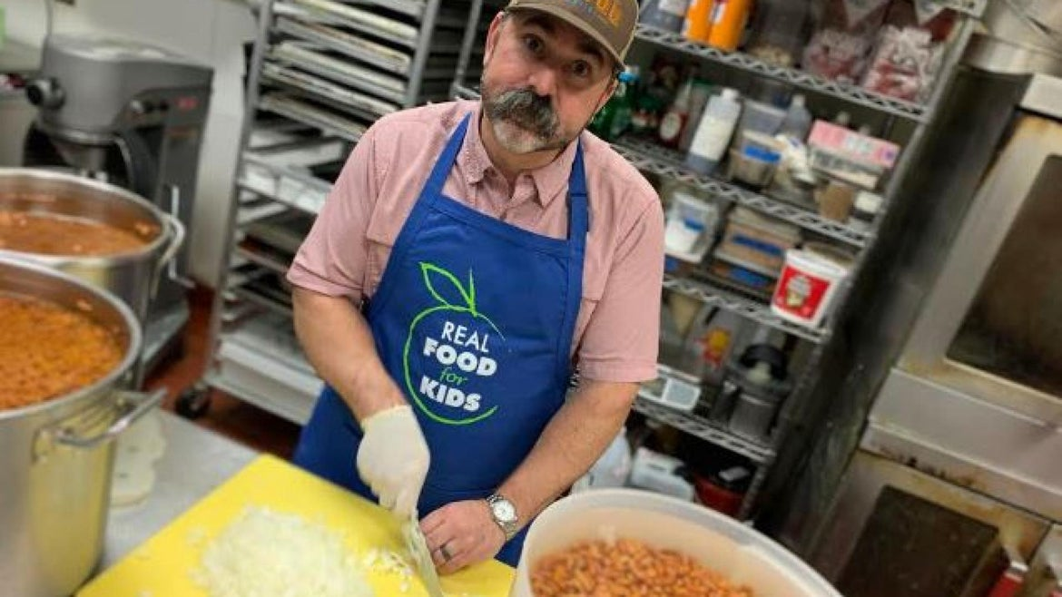 David Guas gearing up to serve 500 free meals on Tuesday.