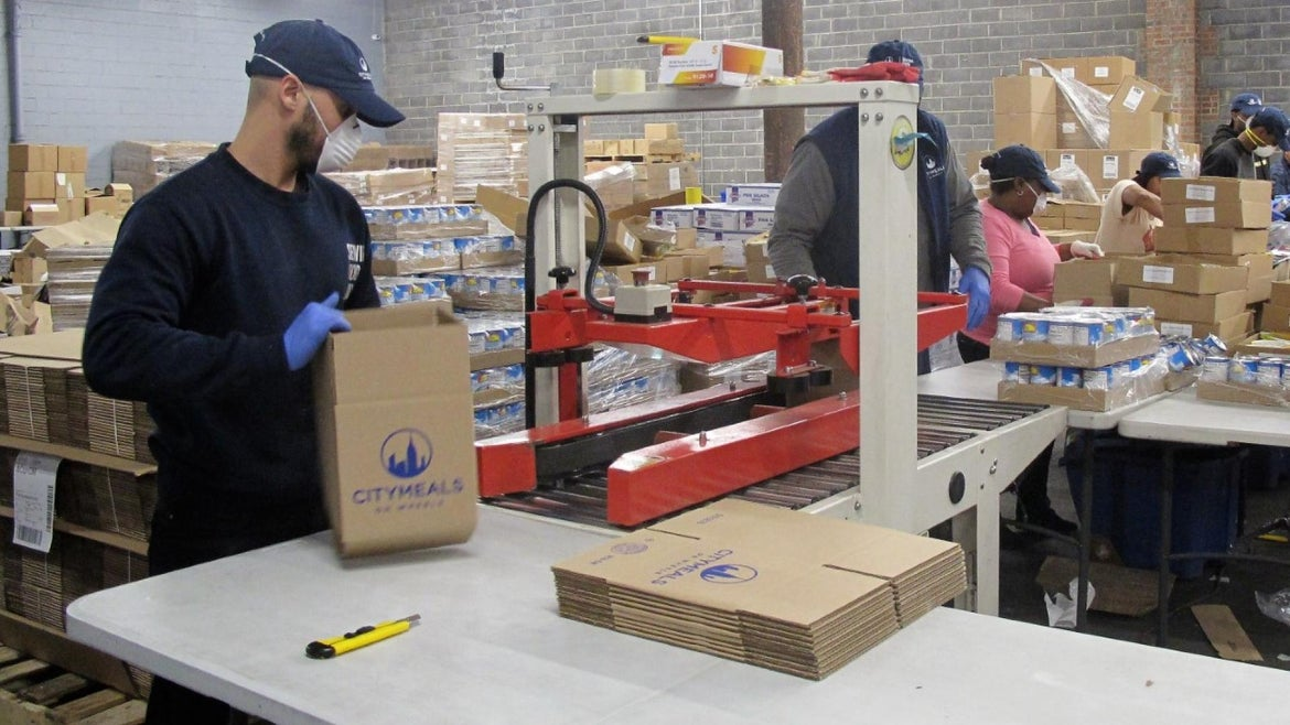 Packing food deliveries for the elderly in New York City.