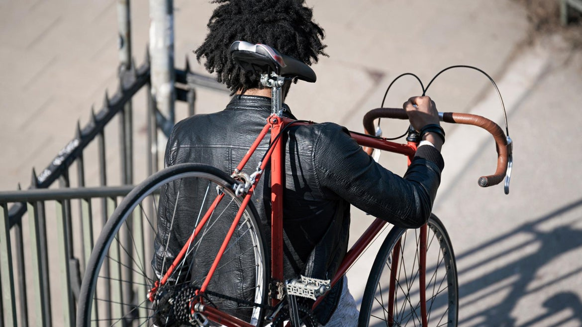 Man carrying his bicycle downstairs (Getty Stock Photo)