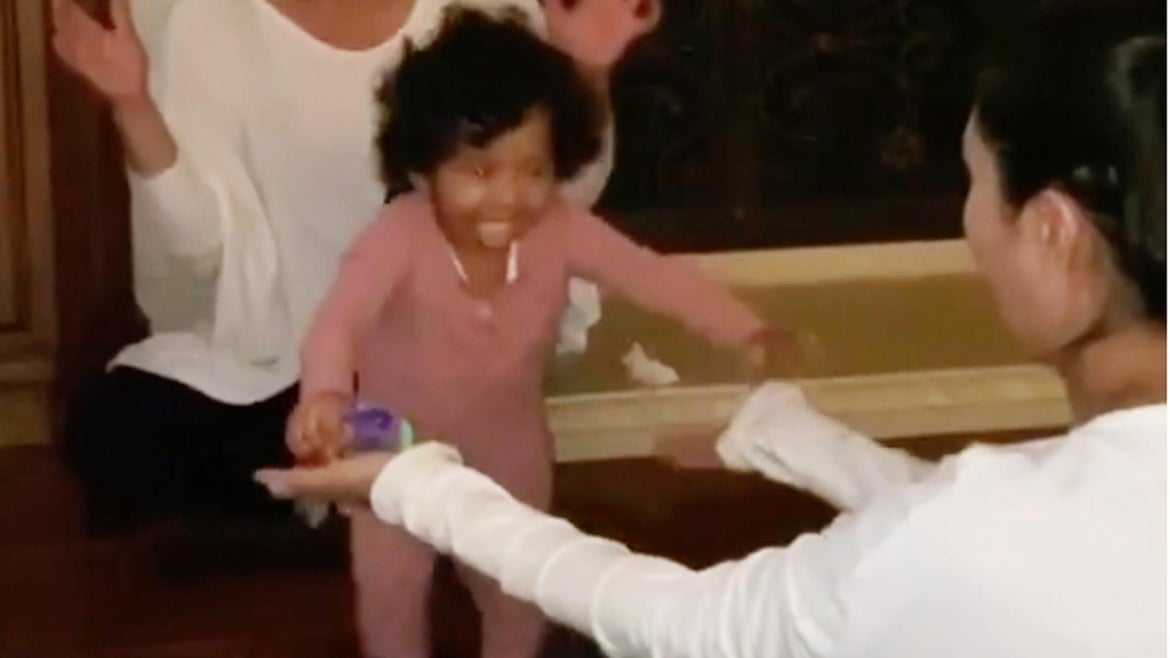 11-month-old Capri runs right into the arms of her mom as she takes her first steps.