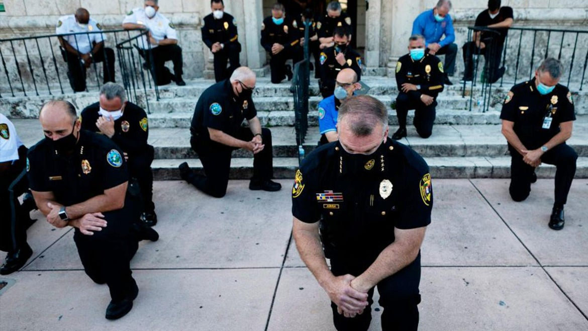 Cops in Coral Gables, Florida, kneel in solidarity with the protesters against the killing of George Floyd.