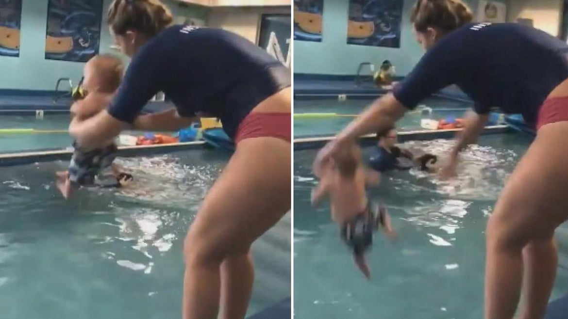 Mother tossing her baby in a pool