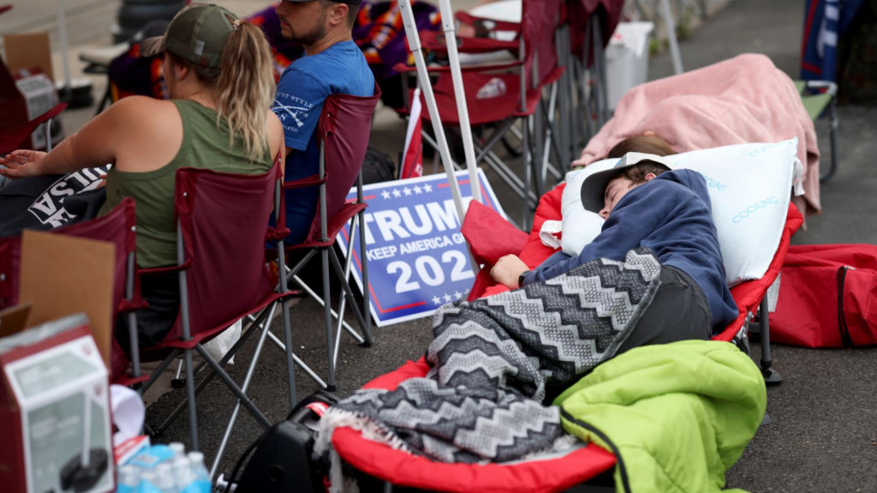 People sleep while lining up for Trump's Tulsa rally.