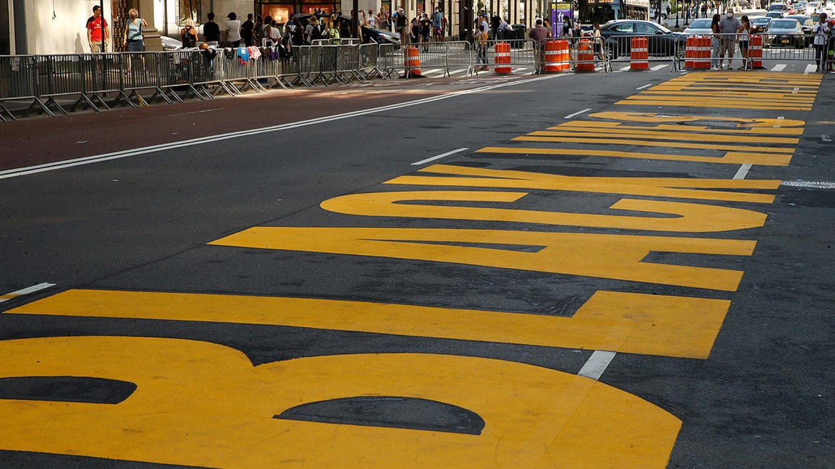 Black Lives Matter painted on a roadway