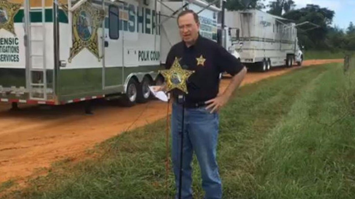 Polk County Sheriff Grady Judd gives a press conference near where three young men were found murdered Friday night.
