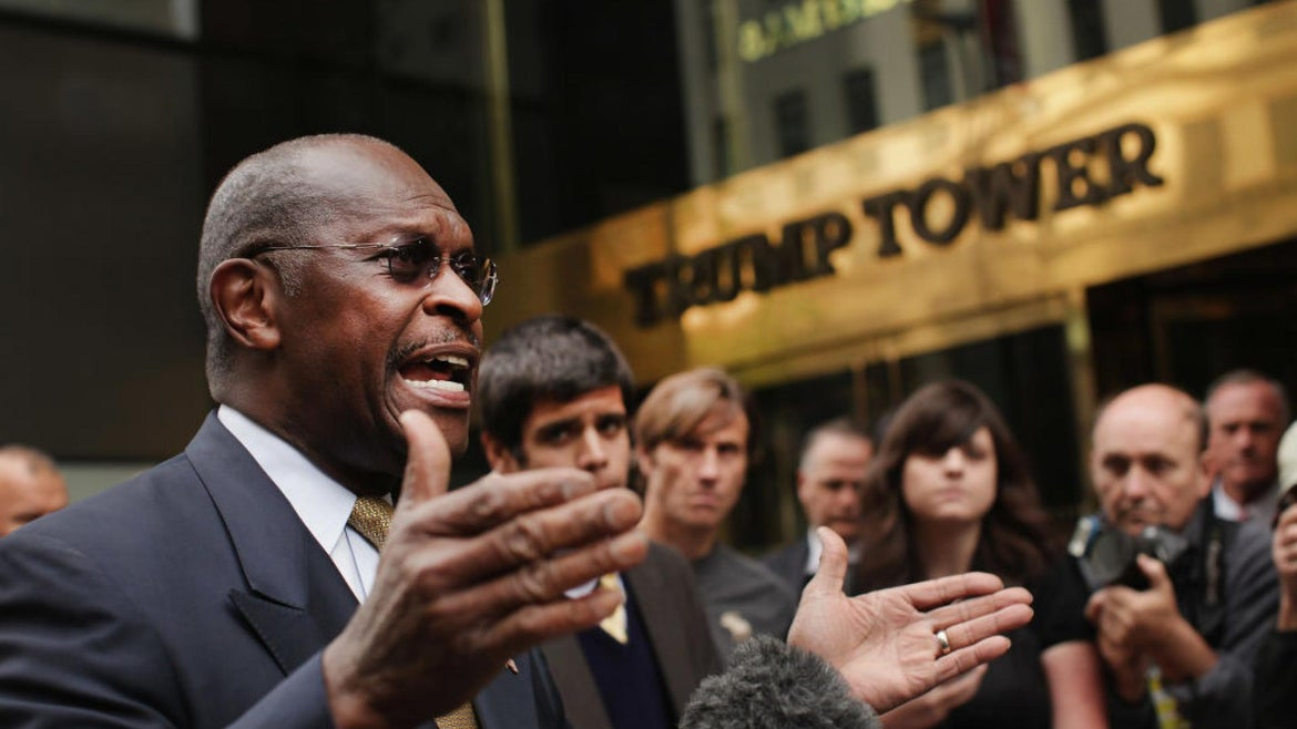 Herman Cain appearing outside Trump Tower voicing support for the candidate.