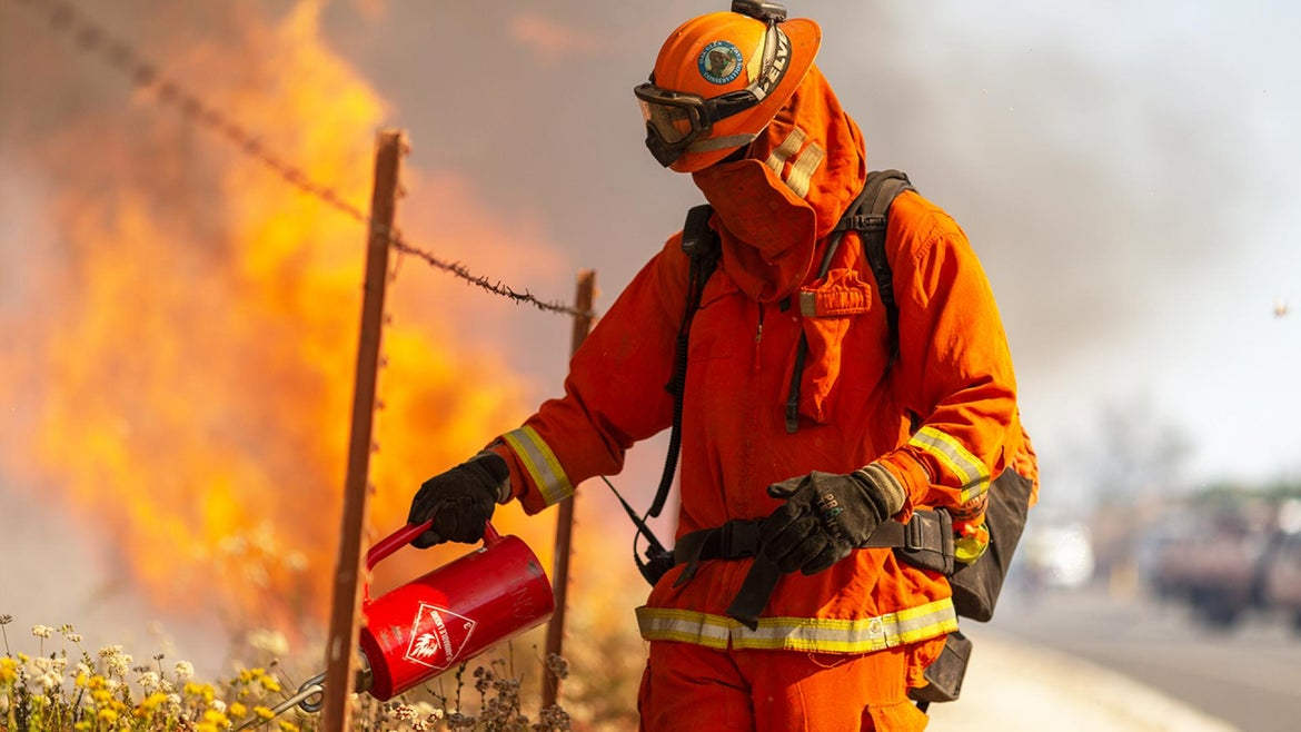 An inmate firefighter works on the front lines of a California wildfire.