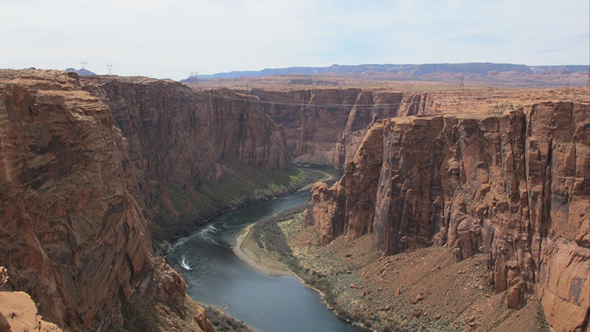 River curves in a deep high walled sandstone canyon. Colorado River from the Dam Overlook
