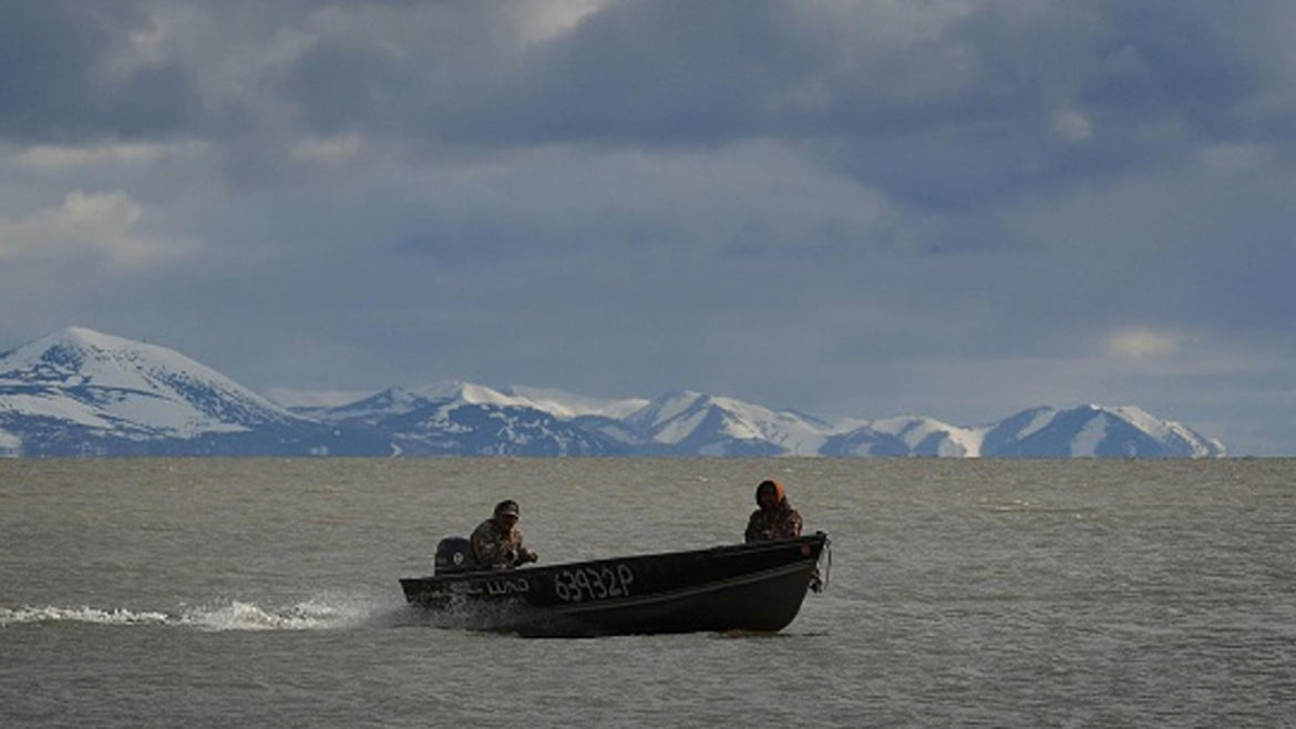 Two hunters return from a trip off Bering Sea