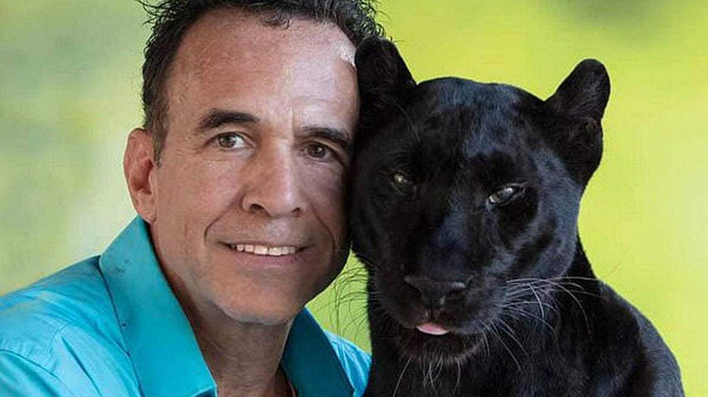 Michael Poggi pictured with his black leopard