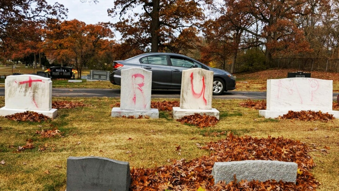 """The ADL Michigan shared images of the headstones defaced with graffiti reading """"MAGA"""" and """"TRUMP."""""""
