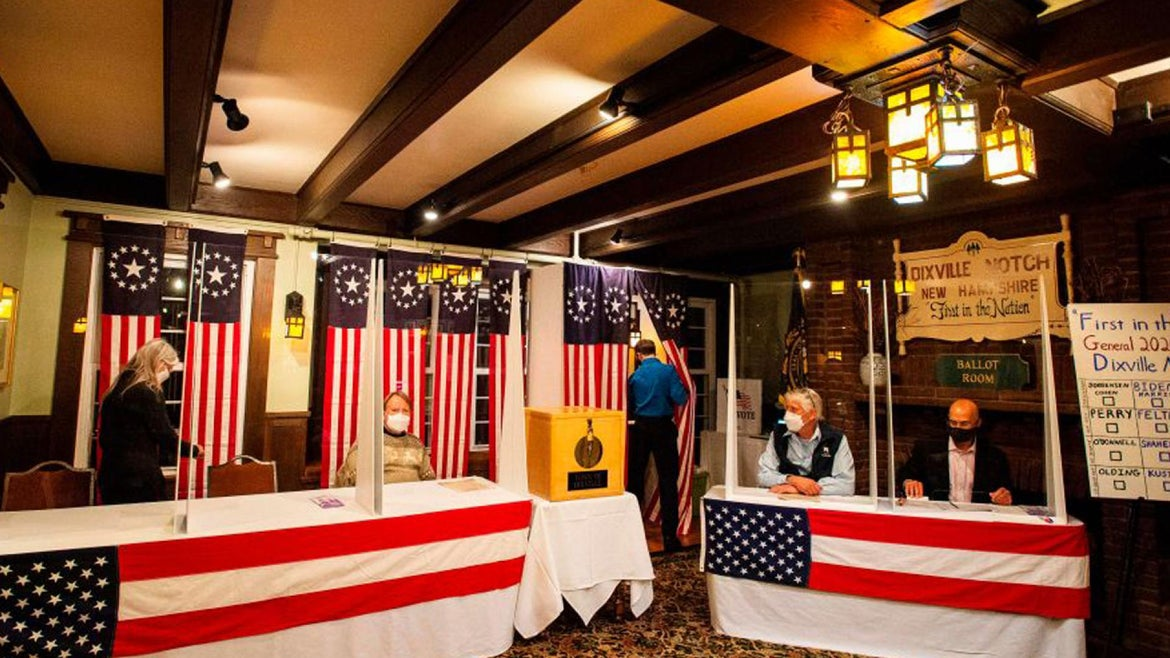 Voters fill out their ballots at the Hale House at the historic Balsams Resort during midnight voting as part of the first ballots cast in the United States Presidential Election in Dixville Notch, New Hampshire on November 3, 2020.