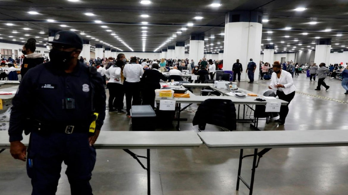 Police responded after chaos erupted at Detroit election center.