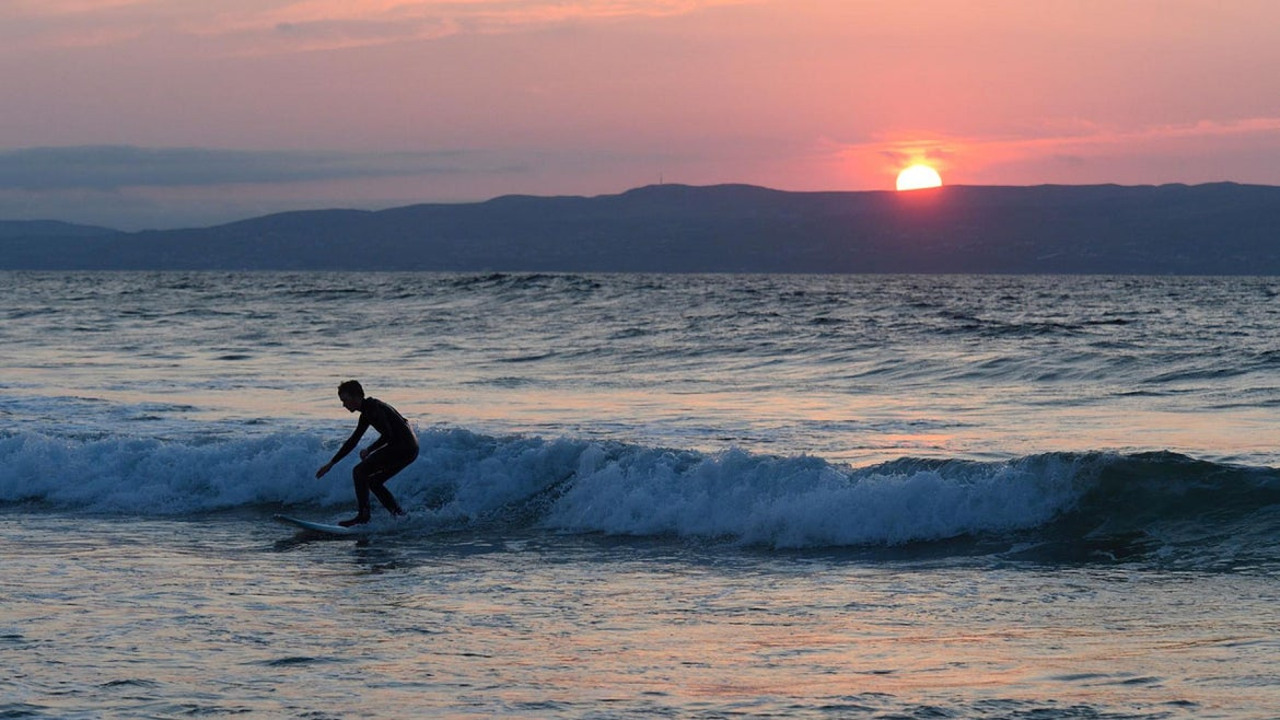 A surfer in Ireland's Donegal area.