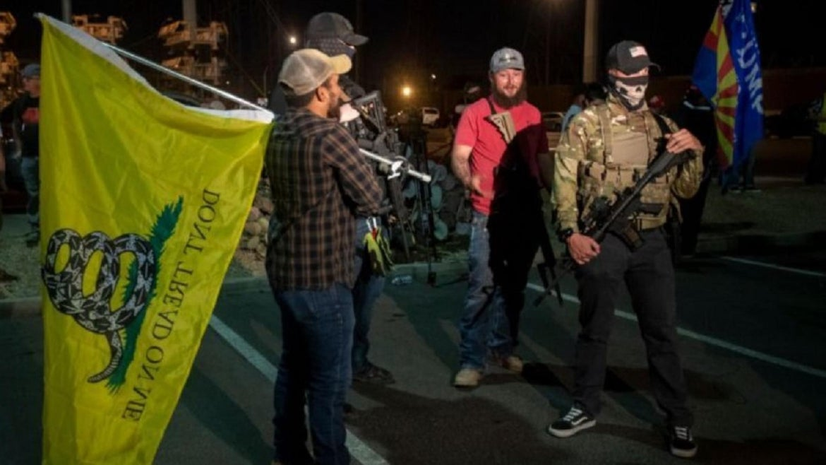 Armed protesters storm Arizona counting facility Thursday night.