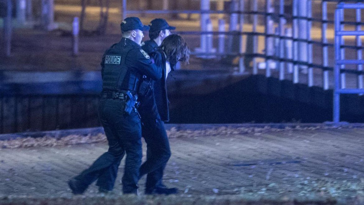 Police officers detain a suspect near the National Assembly of Quebec, in Quebec City, early on November 1, 2020