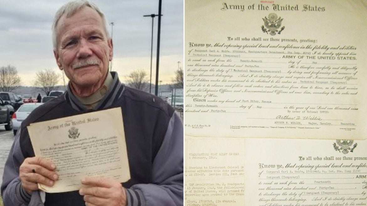 Carl Wolfe, son of Army Sergeant Carl A. Wolfe, holds up service documents from 1942 that were lost at least five years ago.