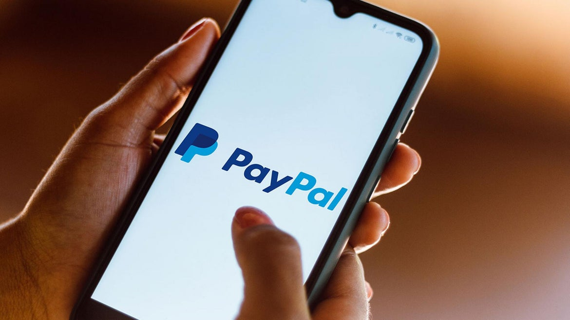 Person uses PayPal on their phone.