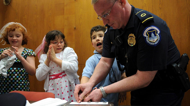 Children get fingerprinted by Capitol Police Officer Howard Liebengood