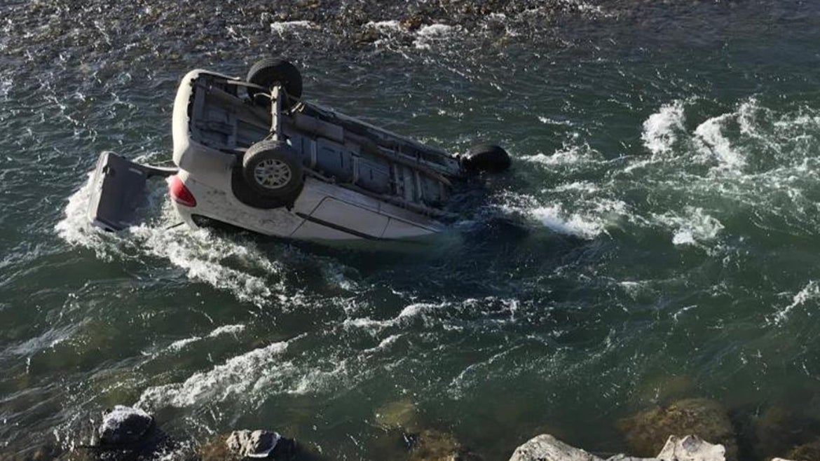 A woman's miraculously survives when her vehicle rolls into Yellowstone River.