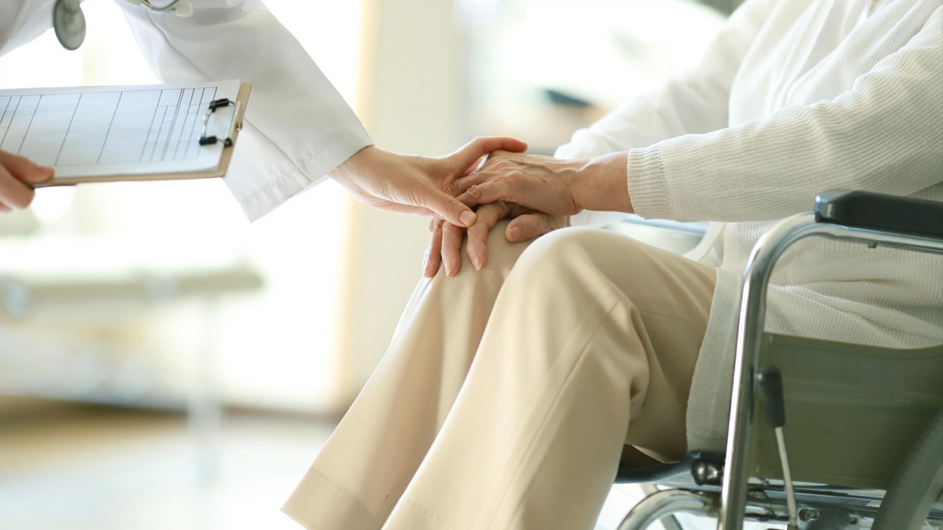 Doctor examining patient in wheelchair