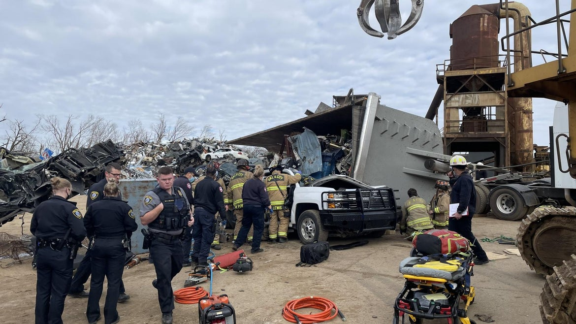 An Oklahoma man was rescued from a scrapyard after crews found him buried beneath thousands of pounds of metal, stuck inside of a mangled truck on Friday