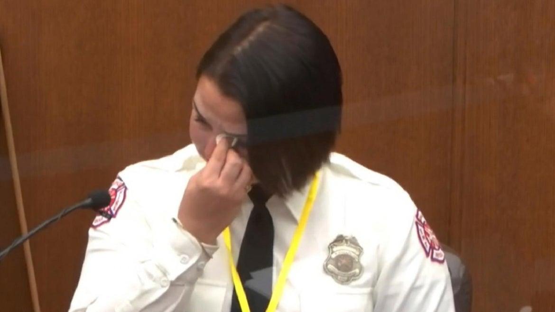 Firefighter Genevieve Hansen wipes her eyes at the murder trial of Derek Chauvin.