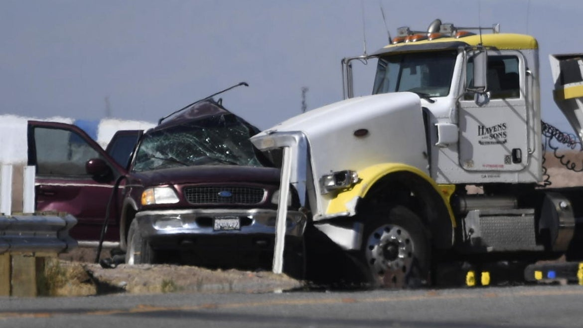 An SUV and a semi-truck full of gravel are seen after an accident near Holtville, California on March 2, 2021.