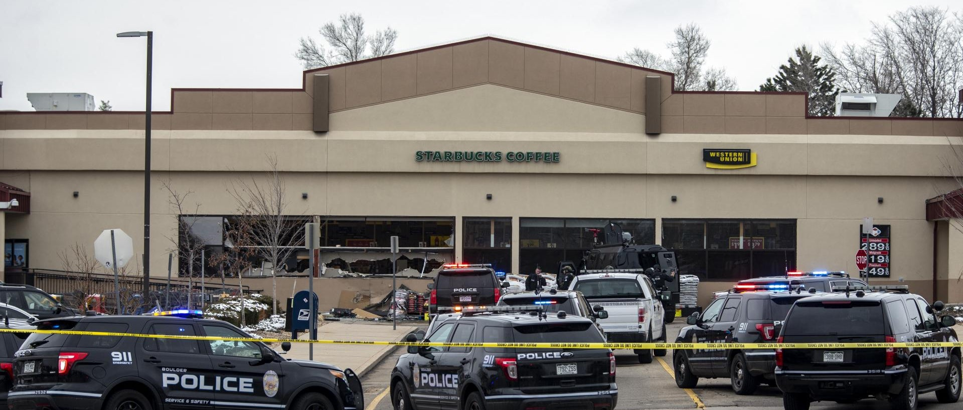 Shattered windows are shown in front of a King Soopers grocery store where a gunman opened fire on March 22, 2021 in Boulder, Colorado. Dozens of police responded to the afternoon shooting in which at least one witness described three people who appeared to be wounded, according to published reports.