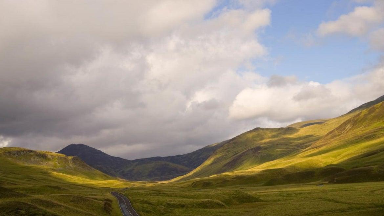 Empty road through the Glen Clunie hills and Grampian Mountains, Scotland near the Scottish Highlands.