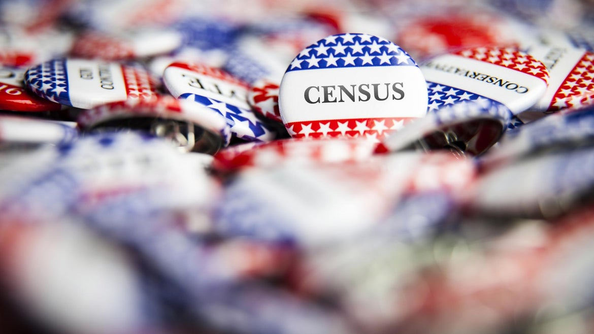 Closeup of button with text that says Census