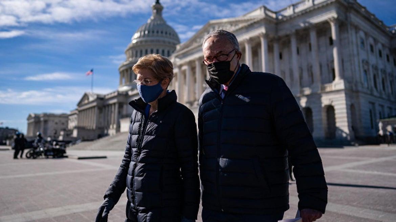 FEBRUARY 4: Sen. Elizabeth Warren (D-Mass.,) and Senate Majority Leader Sen. Chuck Schumer (N.Y.,) arrive for a news conference on Capitol Hill in Washington, D.C., Thursday, February 4, 2021.