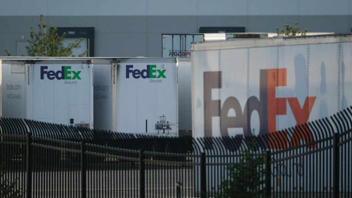 FedEx trailers are parked at the site of a mass shooting at a FedEx facility in Indianapolis, Indiana, on April 16, 2021