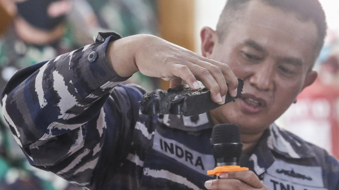 ndonesian Navy personnel shows one of debris from missing Indonesian navy submarine KRI Nanggala 402 displayed during press conference