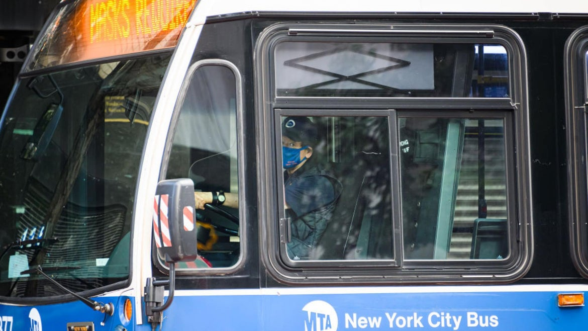 An MTA bus driver wears a protective face mask as New York City moves into Phase 2 of re-opening following restrictions imposed to curb the coronavirus pandemic on June 30, 2020.