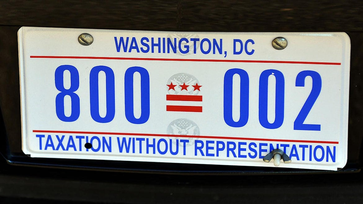 """The license plate of US President Barack Obama's limo is pictured on January 19, 2013 in Washington DC. Obama's limousine is now adorned withe """"Taxation Without Representation"""" license plates."""