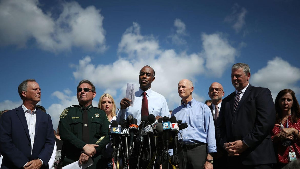 Broward County Superintendent of Schools, Robert W. Runcie (4th L), Florida Governor Rick Scott (4th R) and Broward County Sheriff, Scott Israel (2nd L) speak to the media about the mass shooting at Marjory Stoneman Douglas High School where 17 people were killed on February 15, 2018 in Parkland, Florida.