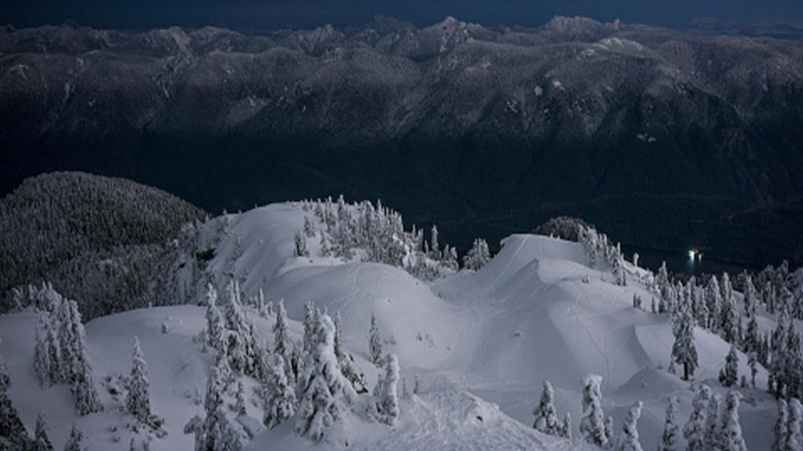 View of snowcapped Mount Seymour at dusk, British Columbia, Canada.